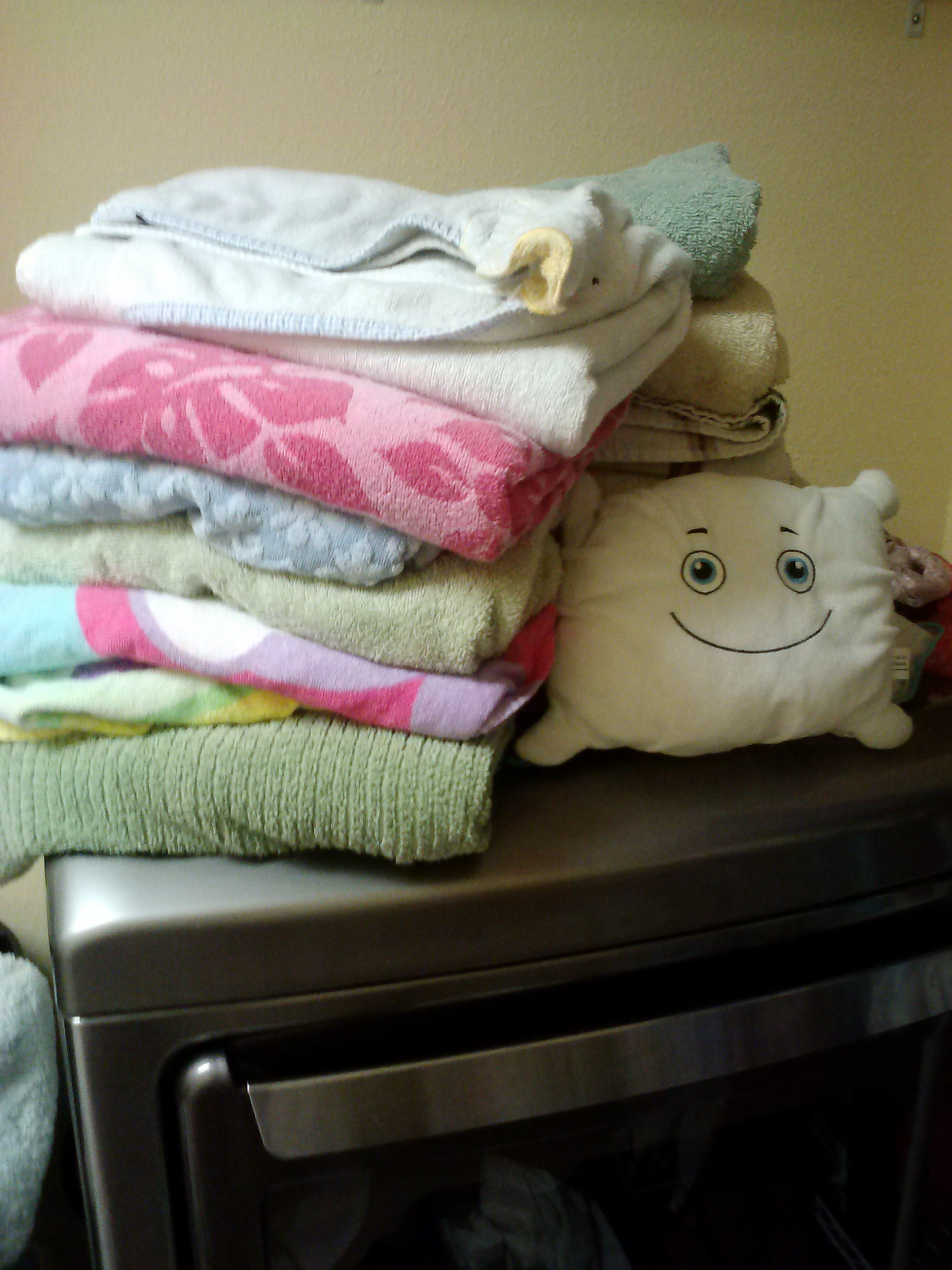 McStuffy is helping daddy fold towels