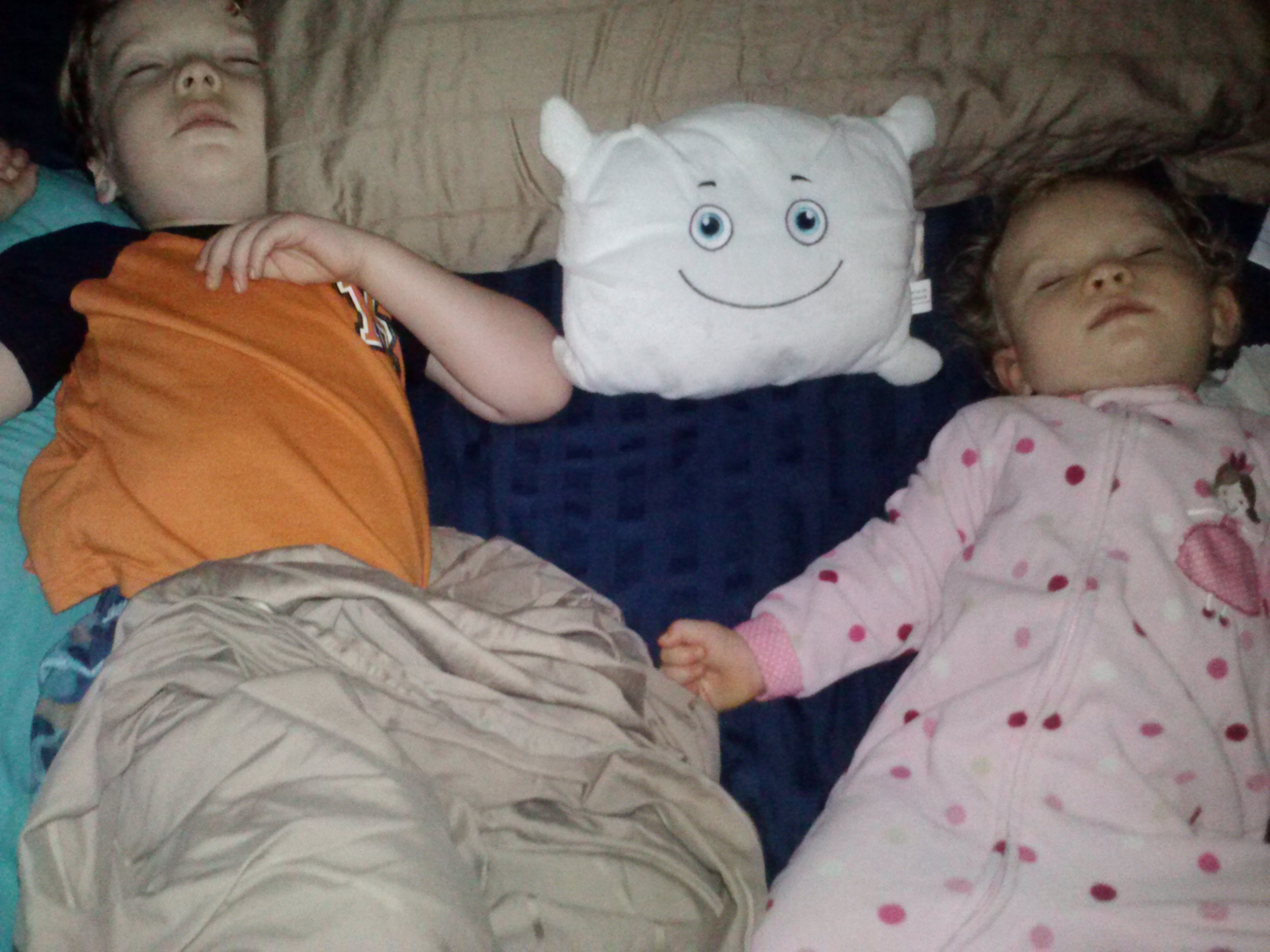 Mommy and daddy really need to work on this sleeping arrangement!
