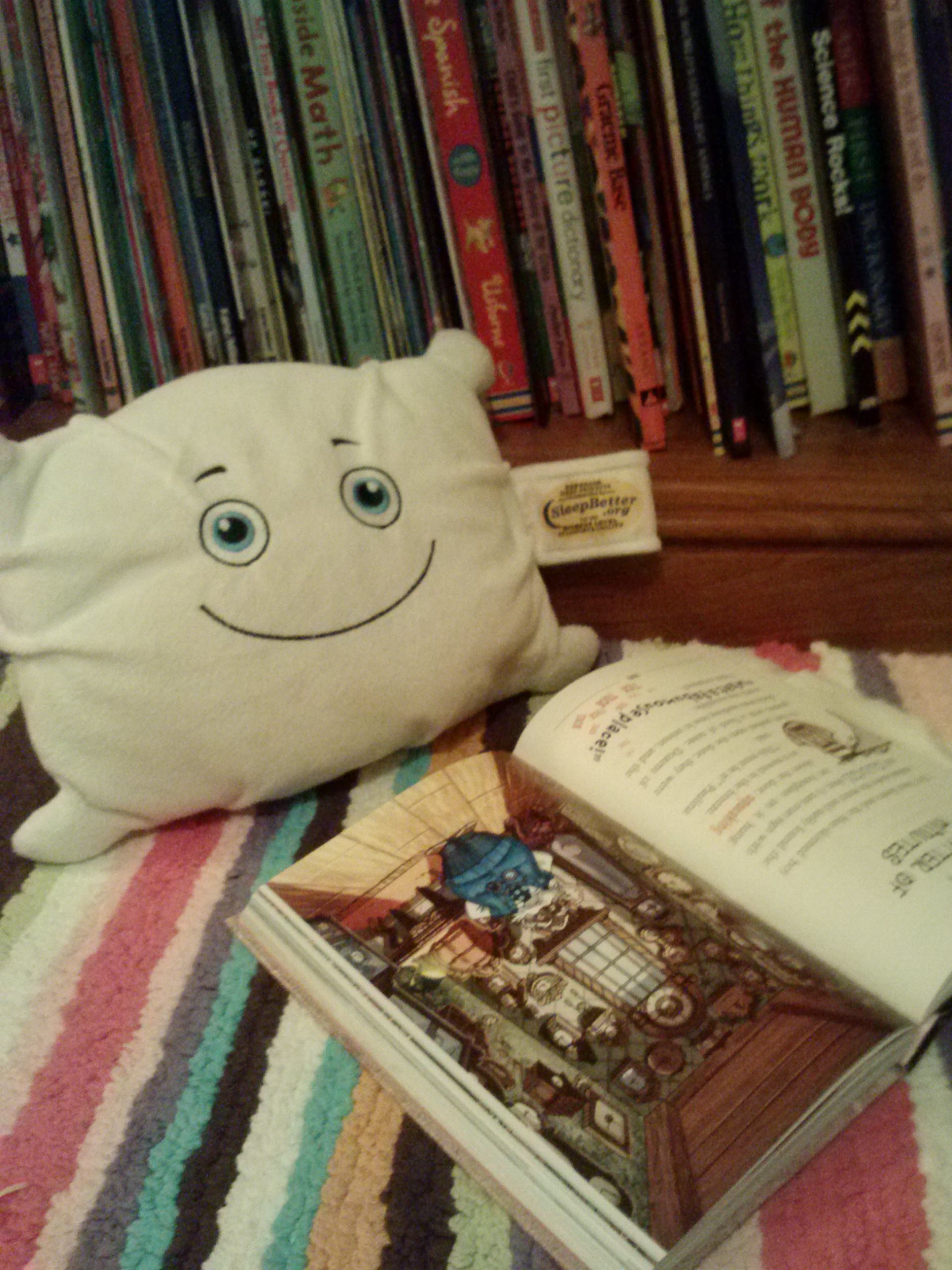 McStuffy is reading a book before turning in for the night