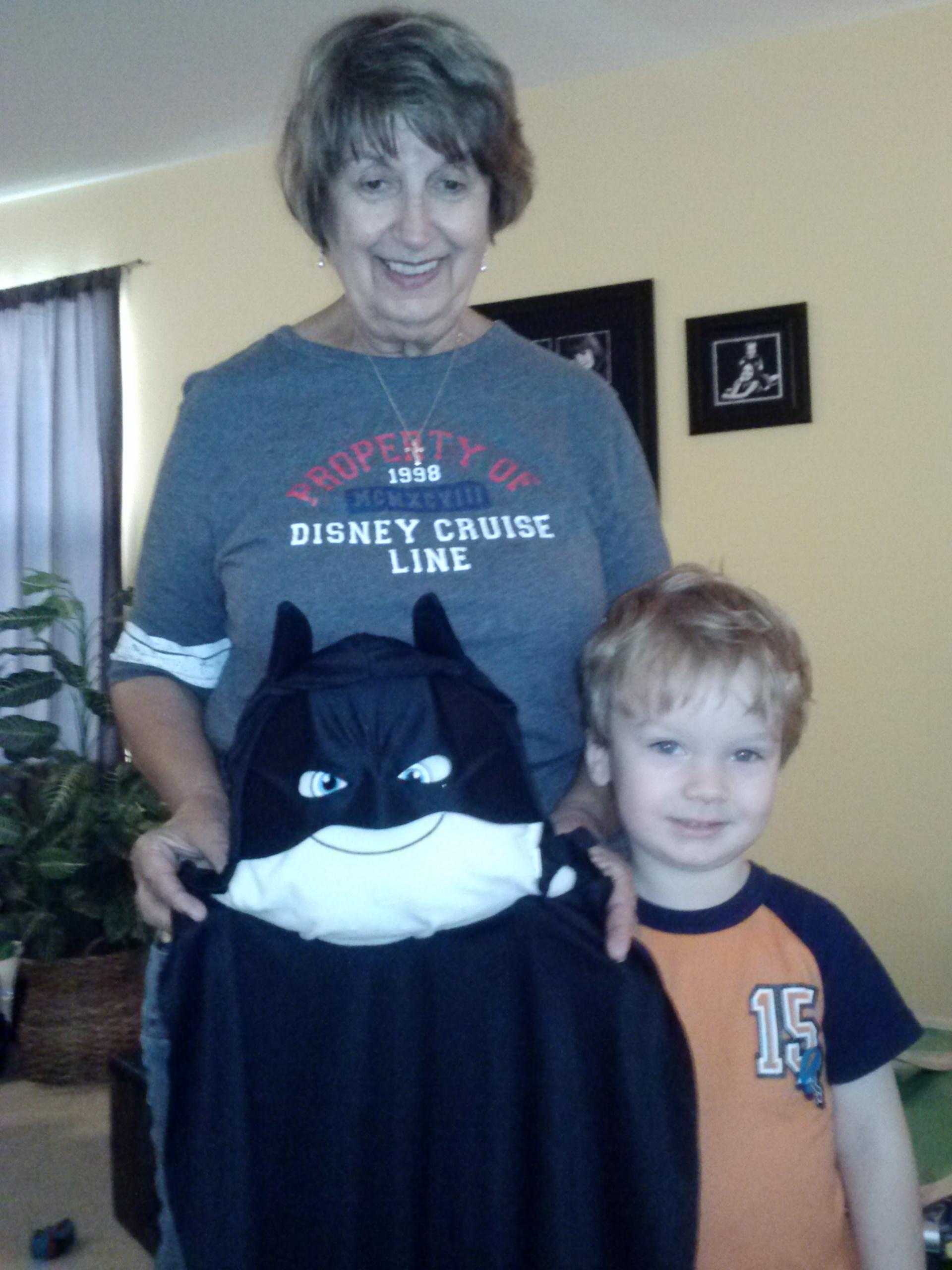 Playing dress up as Batman!