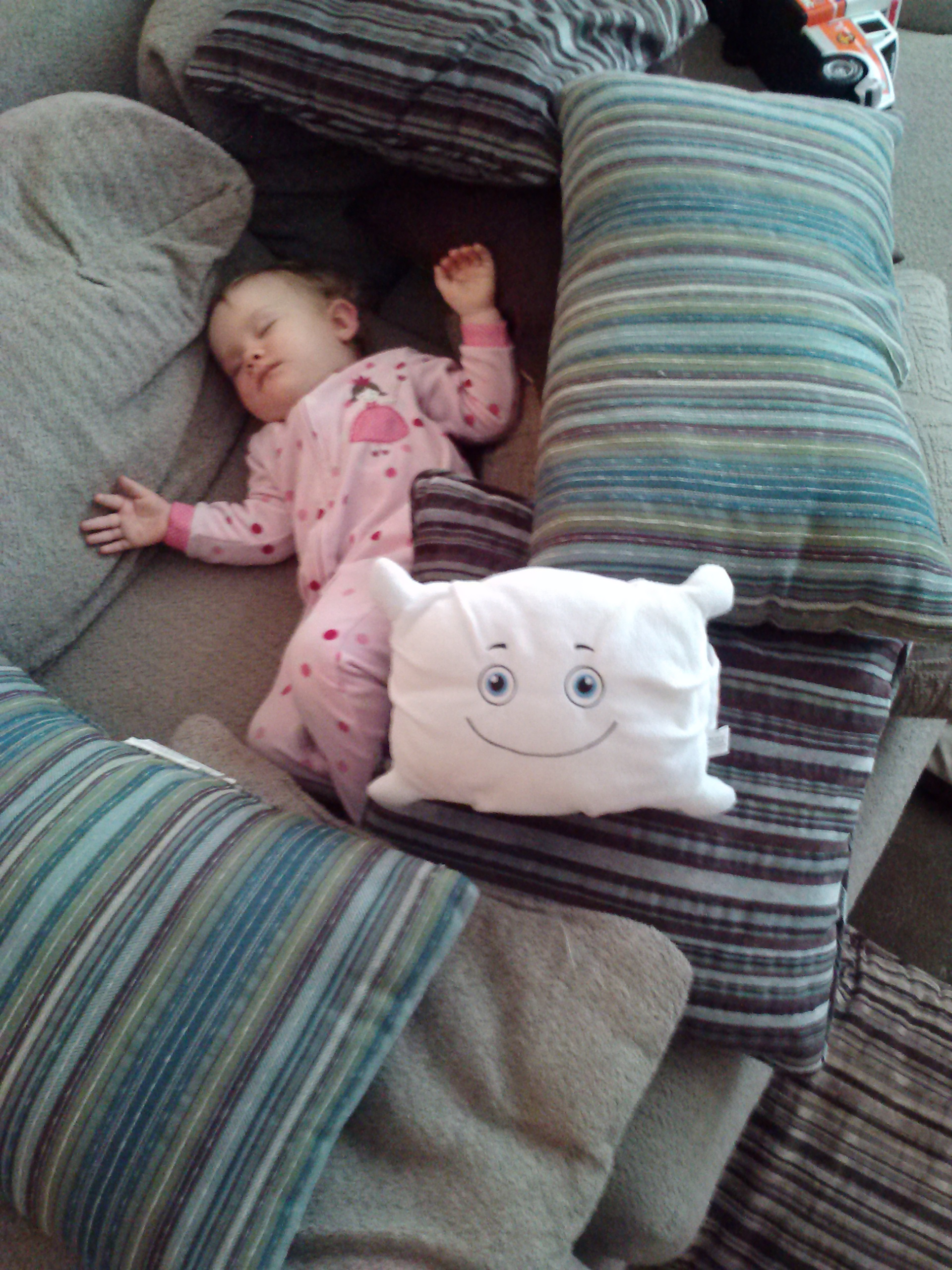 Part of a pillow fortress to protect a napping baby