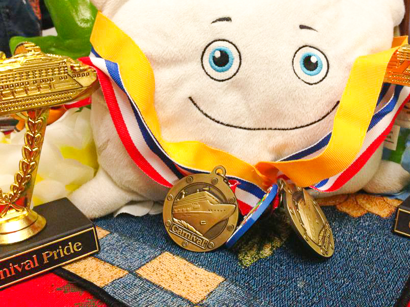 Pillow Featherbed showing off his brother's medals