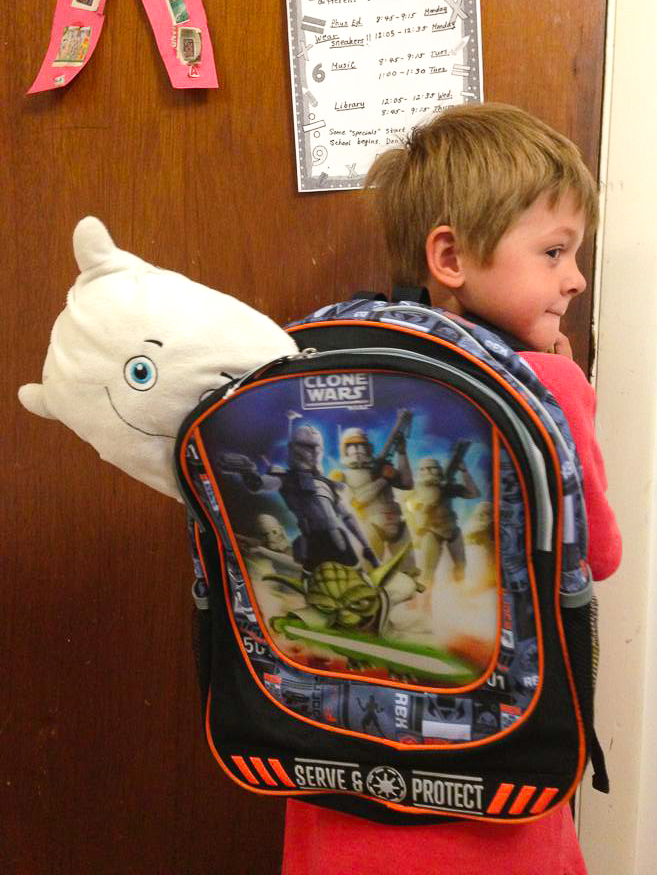 Pillow Featherbed trying to sneak off to kindergarten!