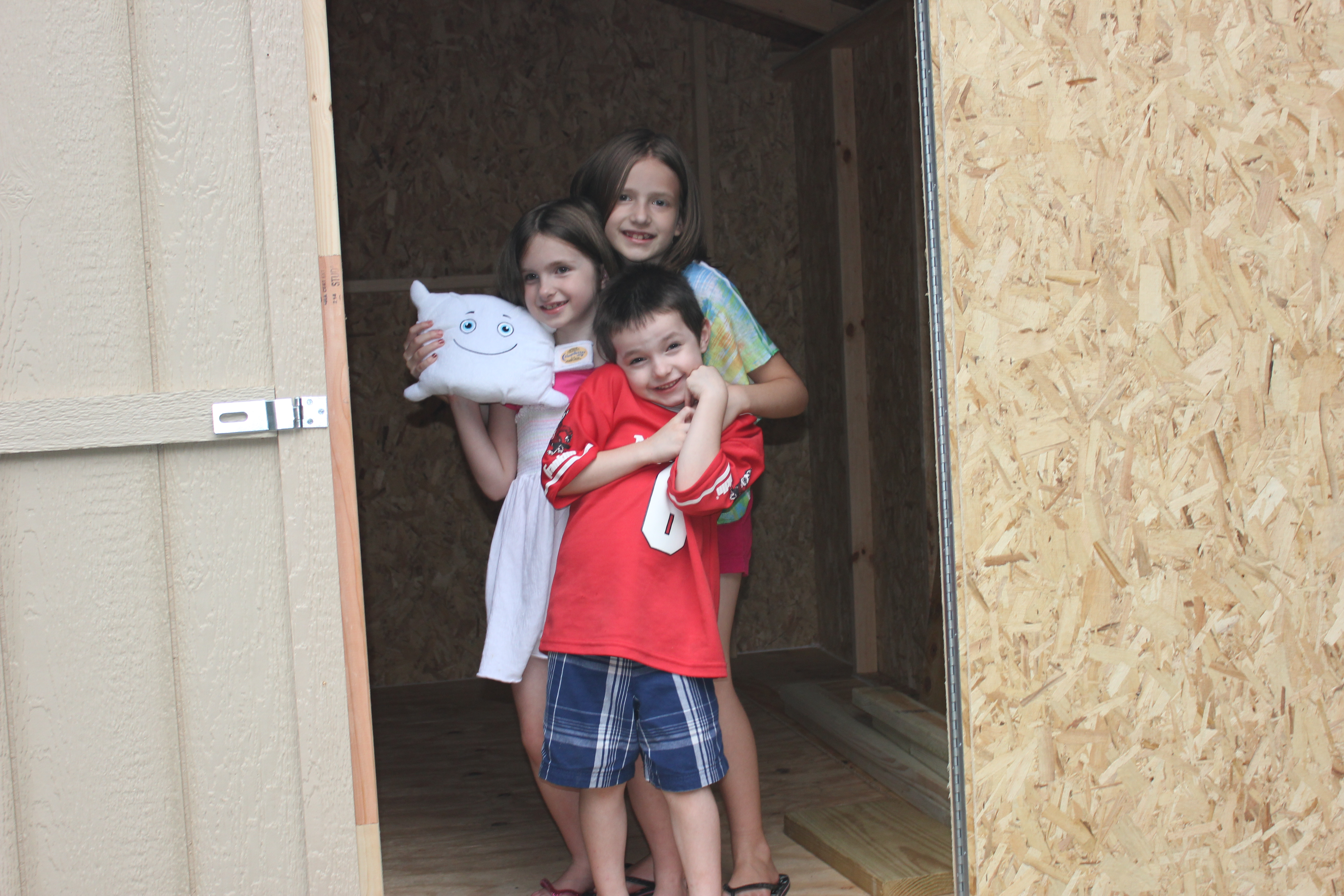 Checking out our new shed with the kiddos!