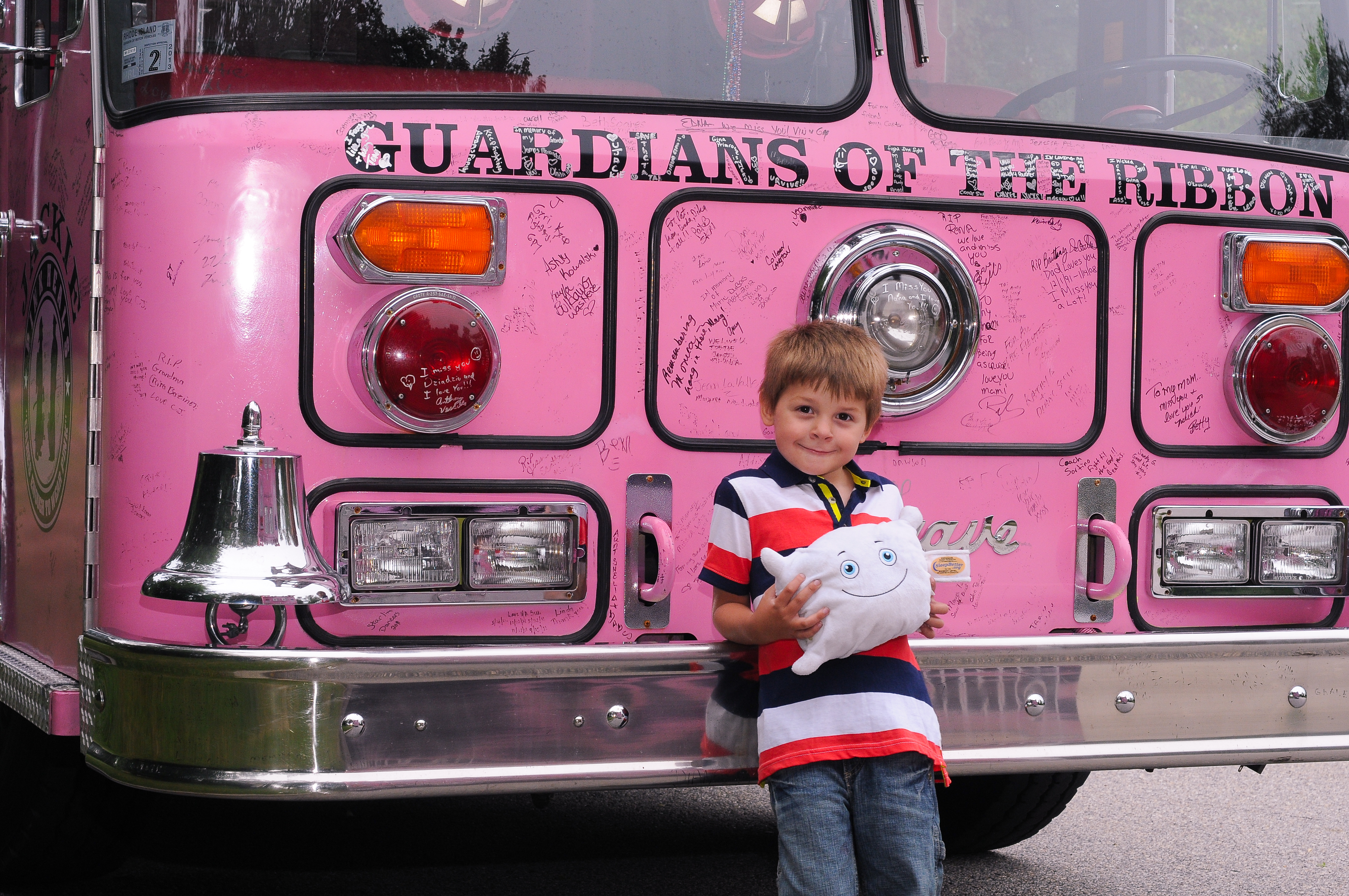 Pillow with the Pink Heals firetruck, raising awareness for breast cancer research