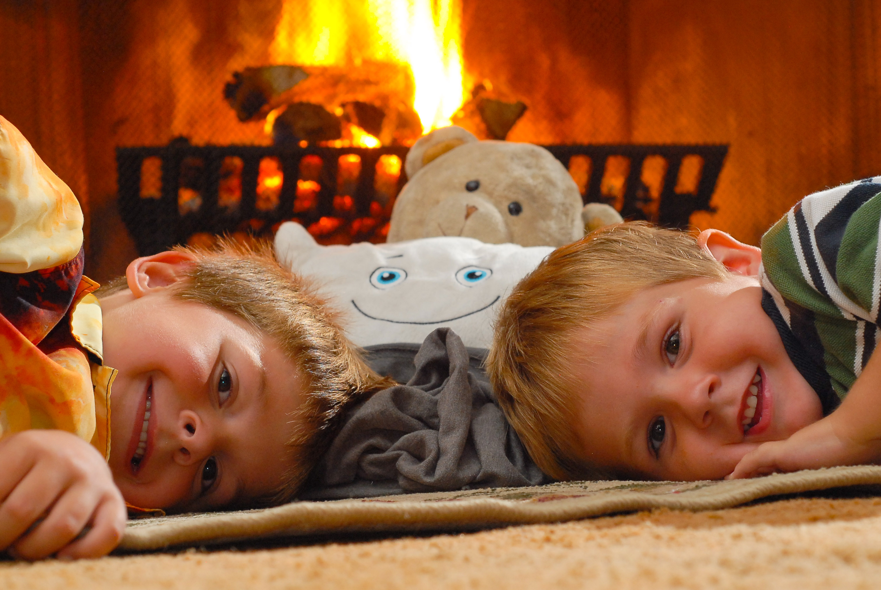 Pillow Featherbed relaxing in front of the fire with BeBe, Caden, and Brady!