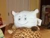 Pillow McStuffy O'Fluffigan on the short neck giraffe...