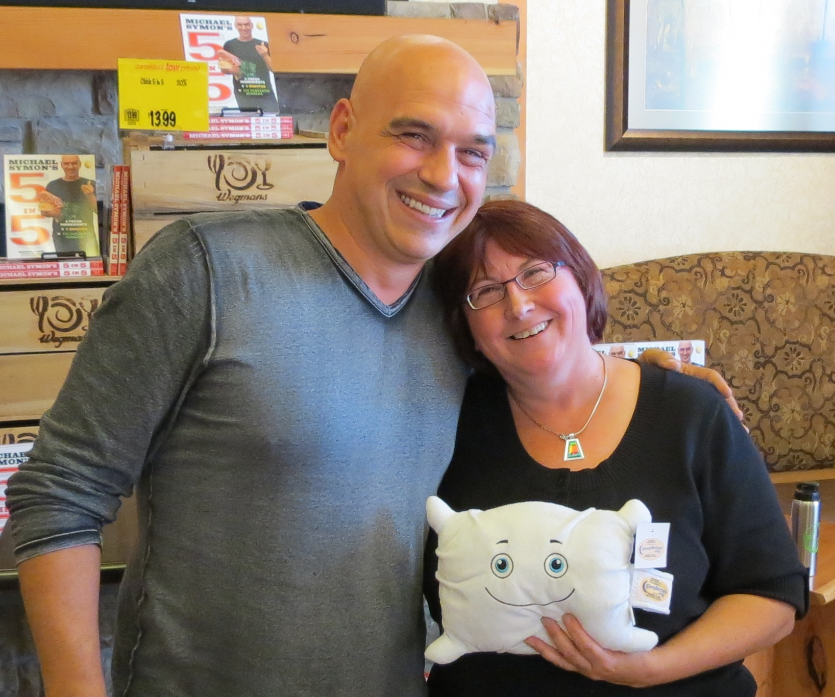 Phil O. and Mom met his favorite celebrity chef- Iron Chef Michael Symon who also co-hosts The Chew. They could only get one picture, so Phil let Mom get in the picture with him.